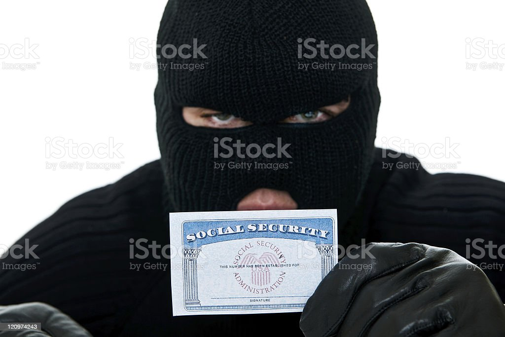 Burglar holding a social security card for ID theft royalty-free stock photo