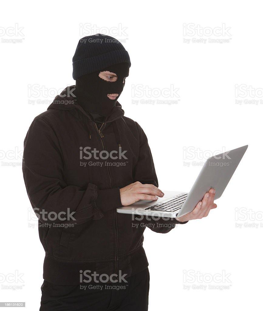Burglar Holding Laptop royalty-free stock photo