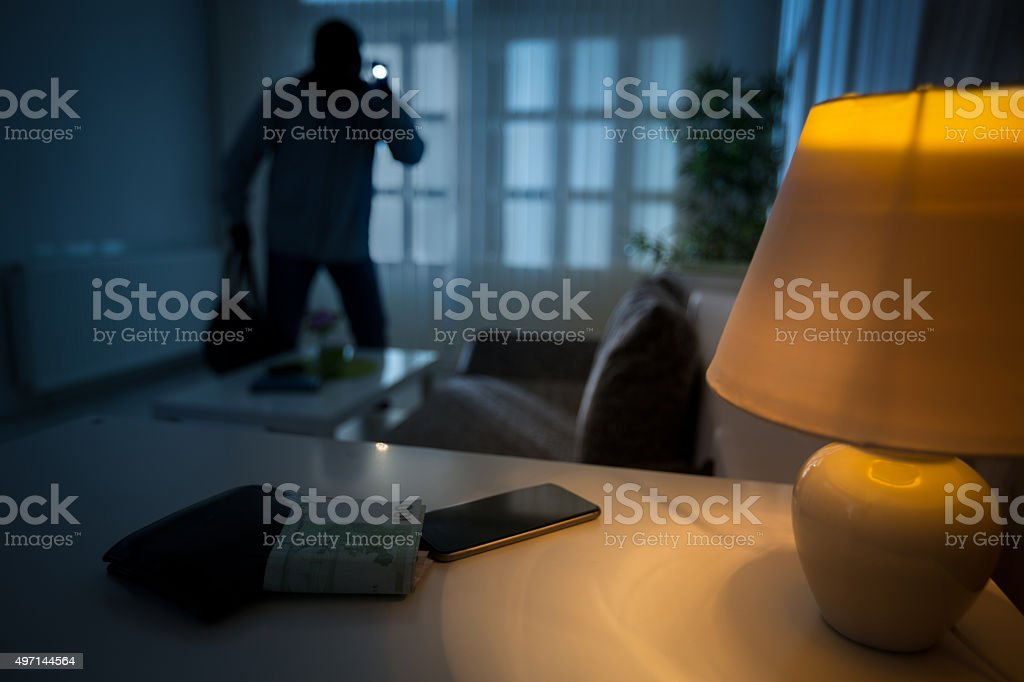 burglar in a house inhabited stock photo