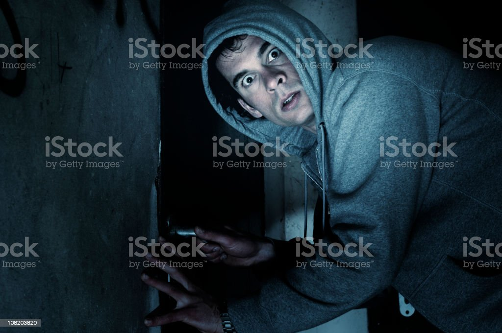 Burglar Man Outside House at Night stock photo