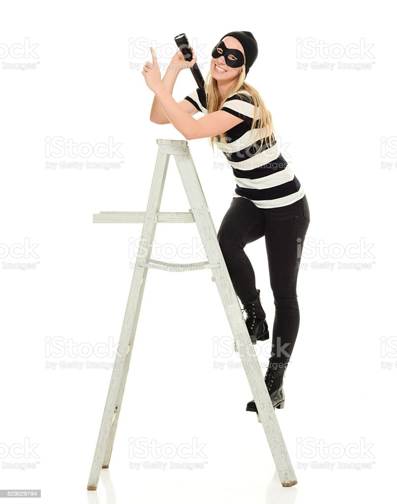 Burglar on ladder and pointing stock photo