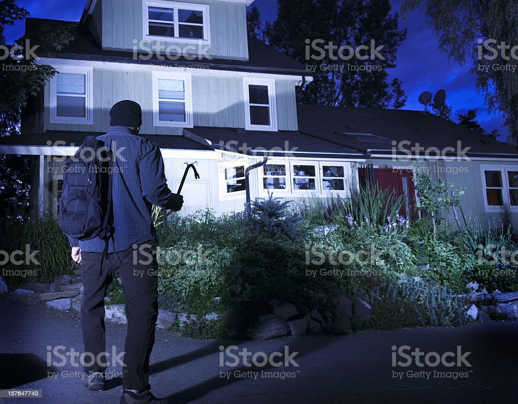 Burglar on the prowl stock photo