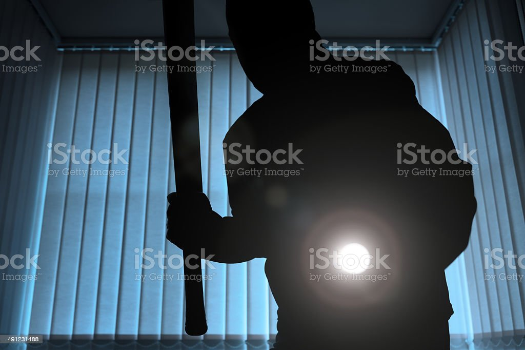 Burglar or intruder at night stock photo