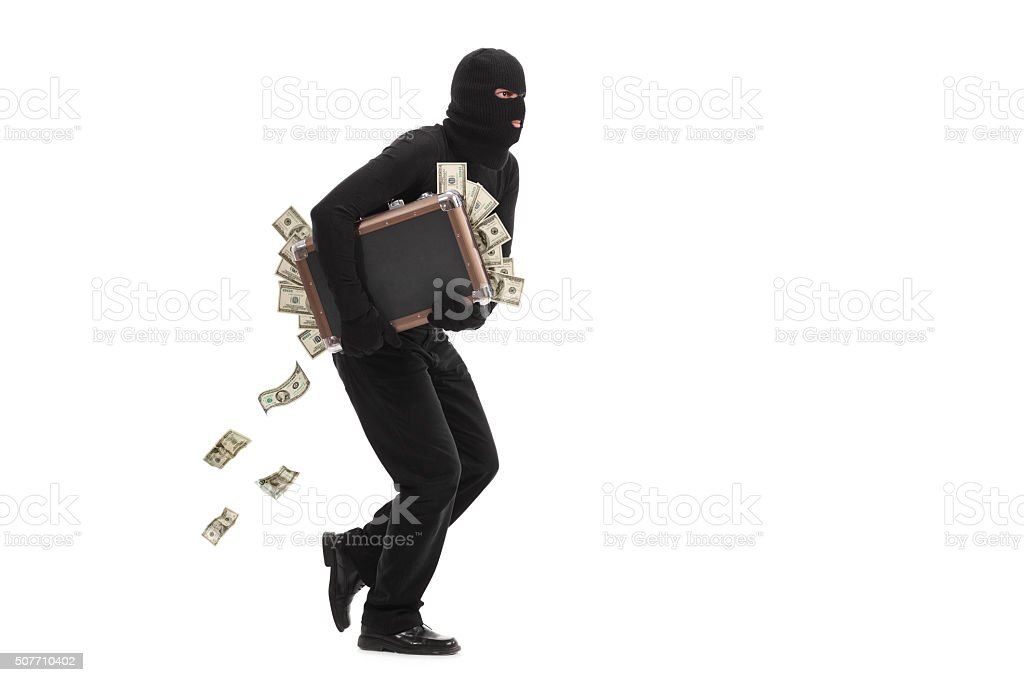 Burglar running with a bag full of money stock photo