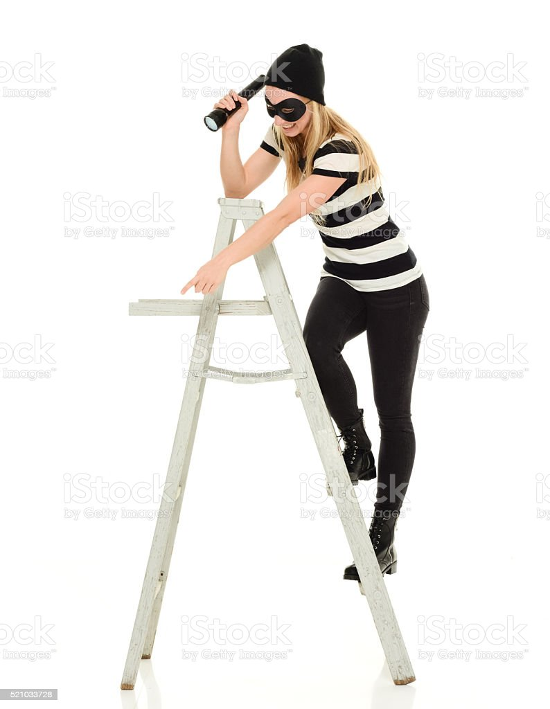 Burglar searching with flash light stock photo