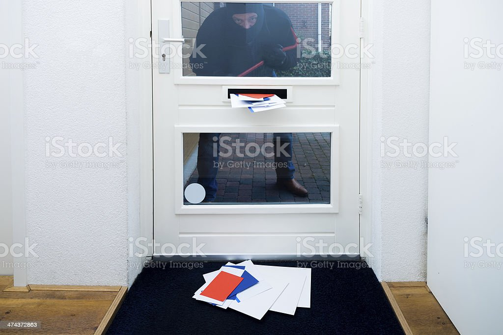 Burglar with a crowbar stock photo