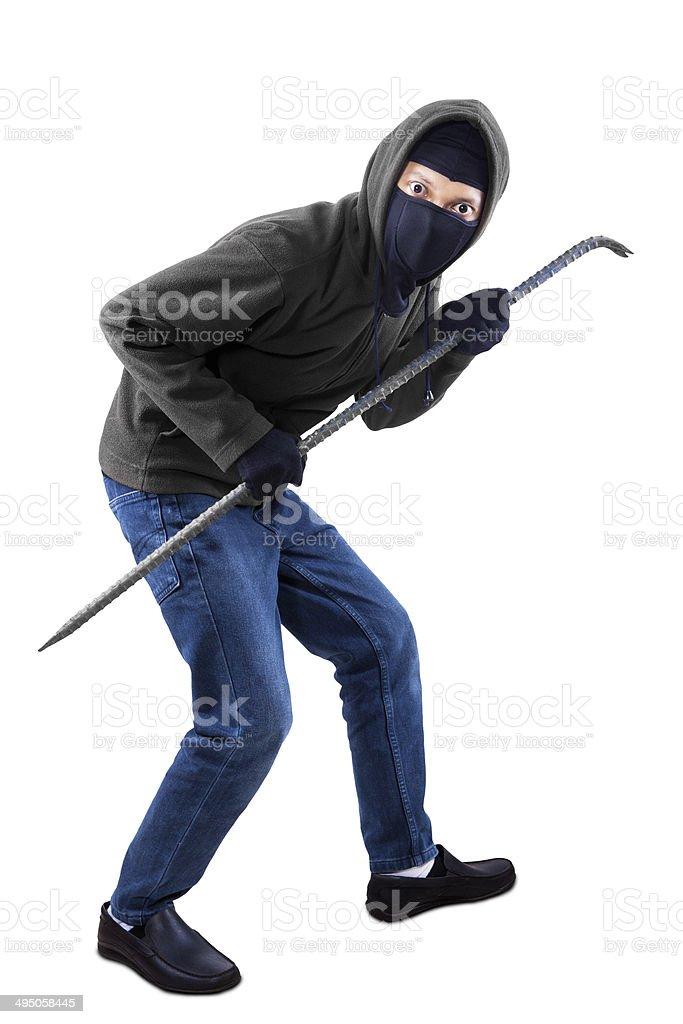 Burglar with a crowbar stock photo