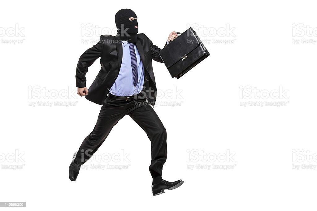 Burglar with robbery mask running away royalty-free stock photo