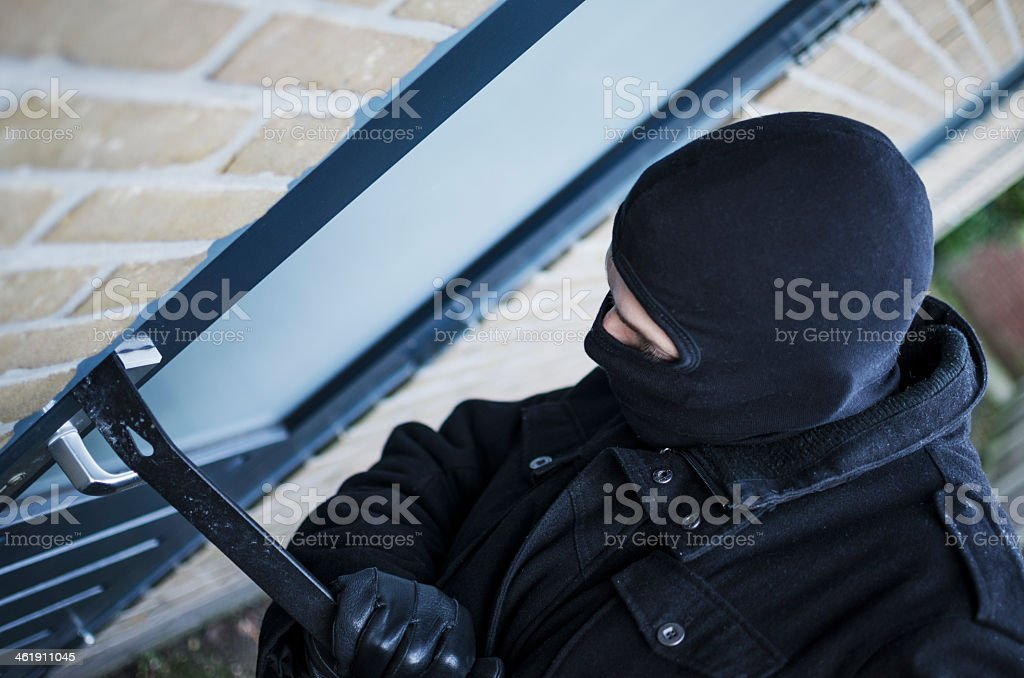 Burglary breaking into a house stock photo