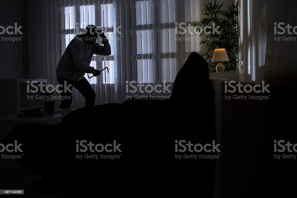 burglary with crowbar breaking into a home stock photo