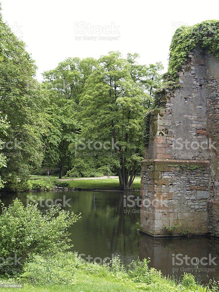 Burgturm im Wassergraben stock photo