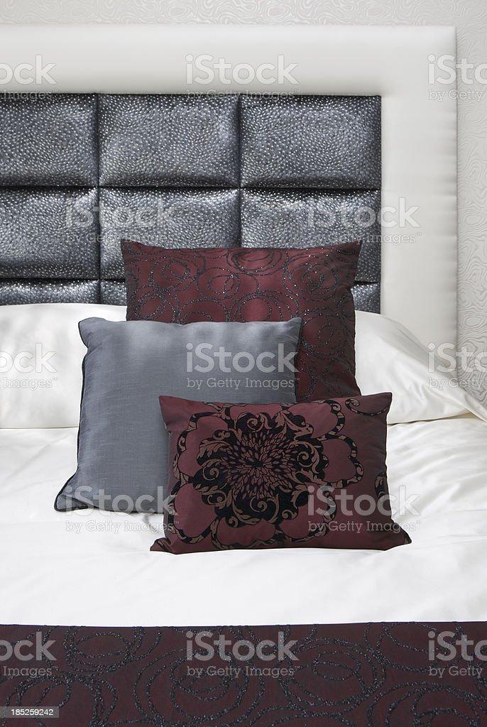burgundy and gunmetal silk cushions stock photo