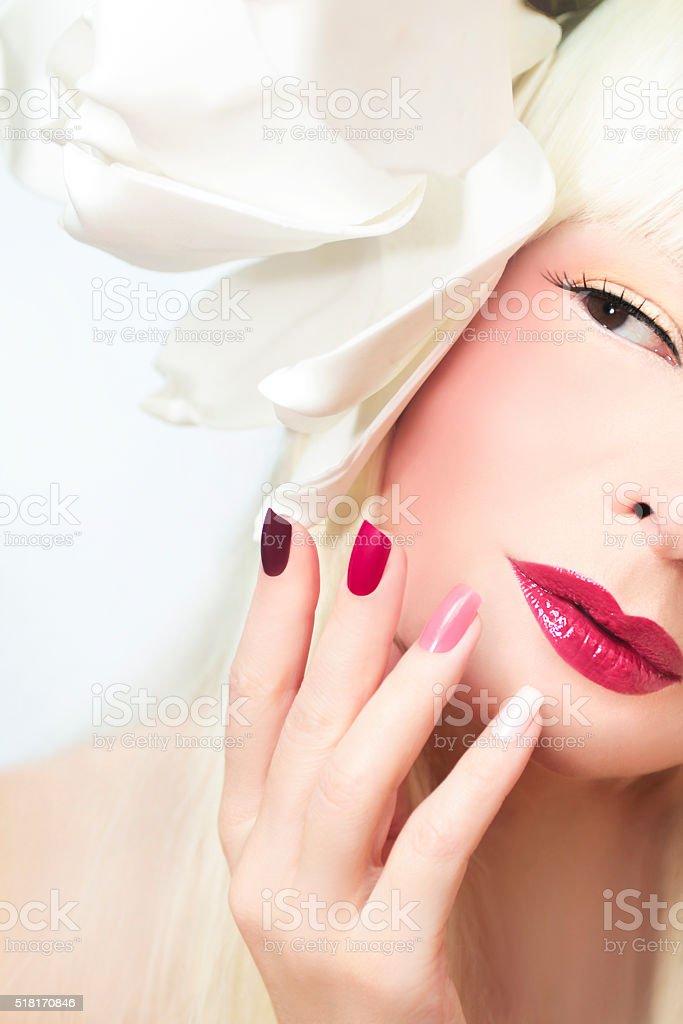 Burgundy multi-colored manicure. stock photo