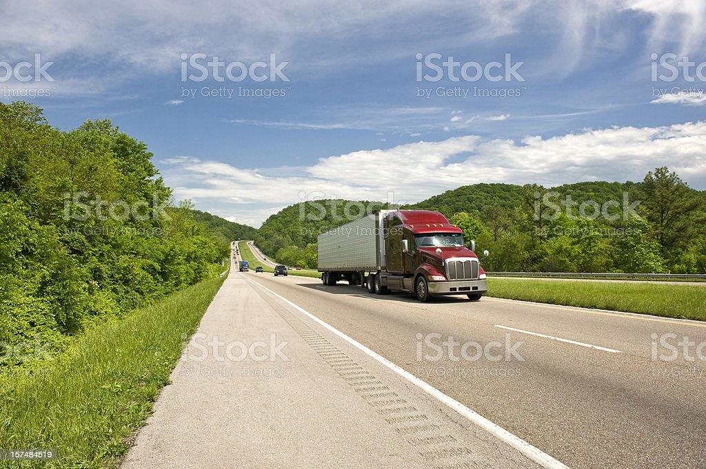 Burgundy Semi Truck On Beautiful Spring Day royalty-free stock photo