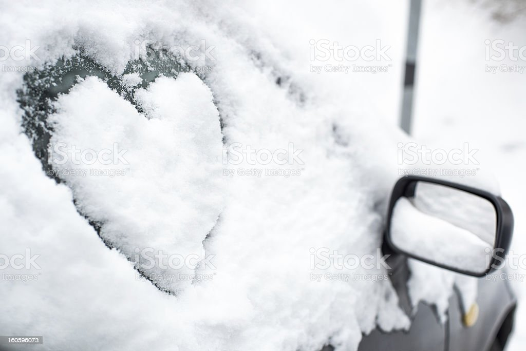 Buried by snow car with heart on side window stock photo