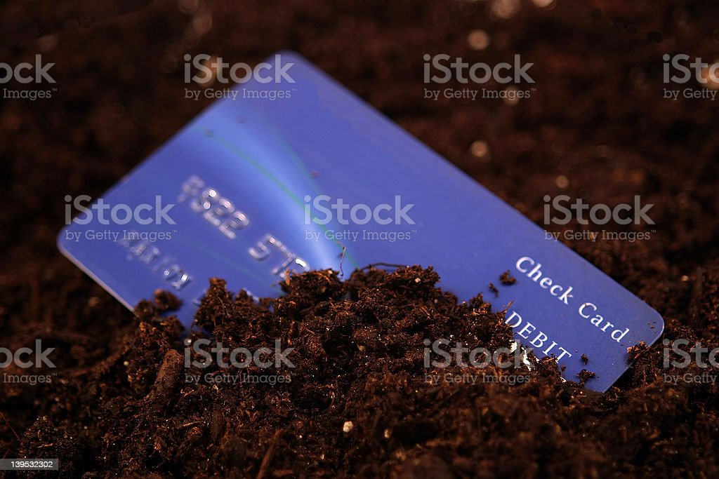 Buried In Debt Narrow Depth of Field royalty-free stock photo