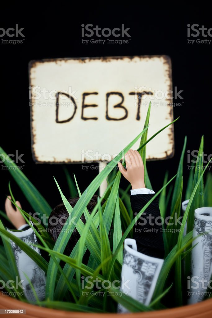 Buried in Debt royalty-free stock photo