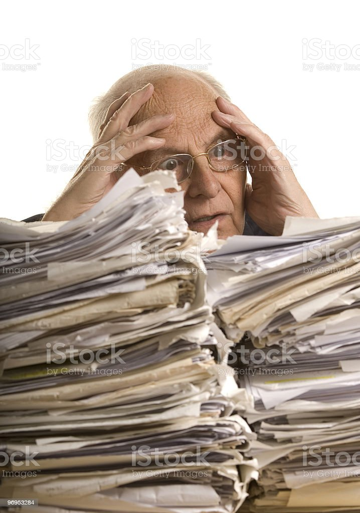 Buried in papers royalty-free stock photo