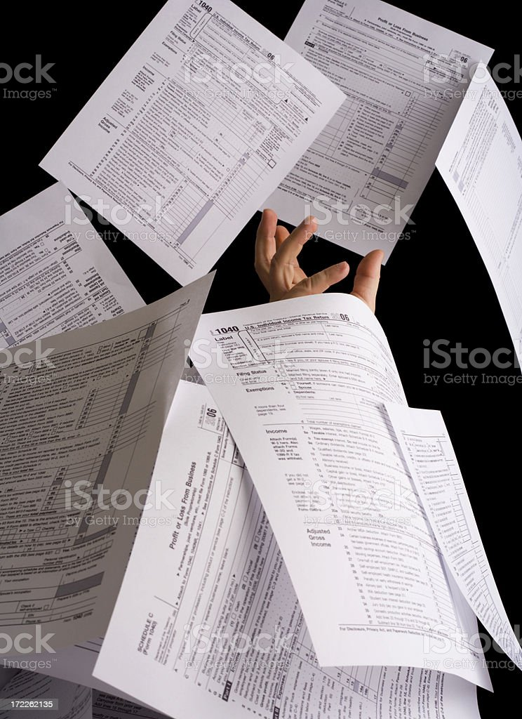 Buried in Tax Forms stock photo