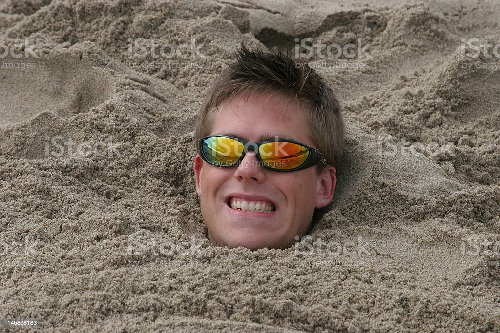 Buried in the sand royalty-free stock photo