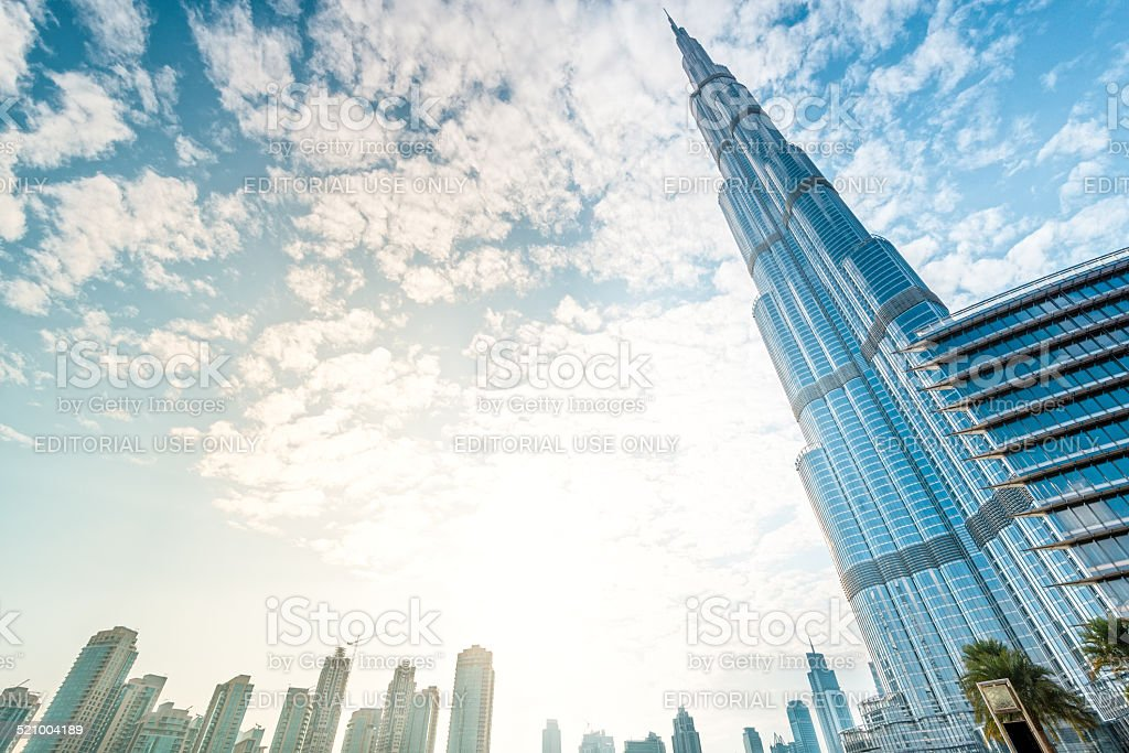 Burj Khalifa vanishing in blue sky in Dubai, UAE. stock photo