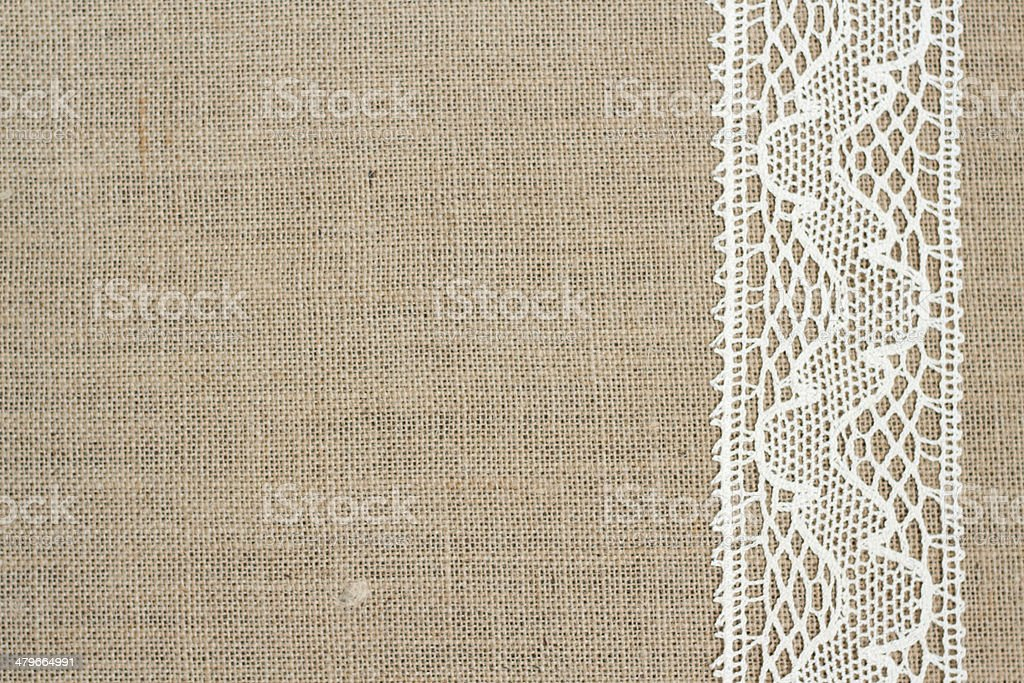 Burlap background with lace stock photo