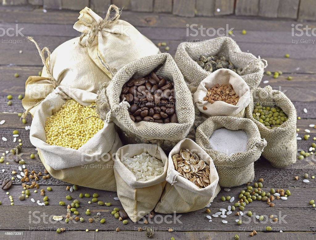 Burlap bags with cereals stock photo