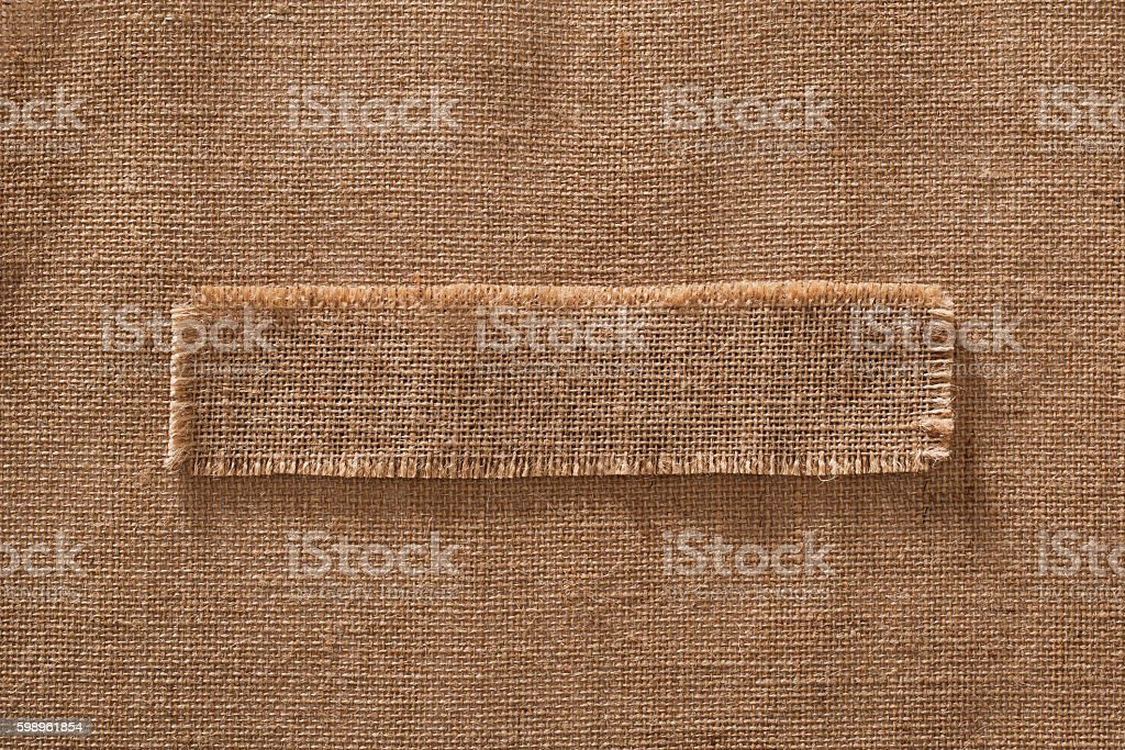Burlap Fabric Frame Piece Label, Sack Cloth Linen Hessian Background stock photo
