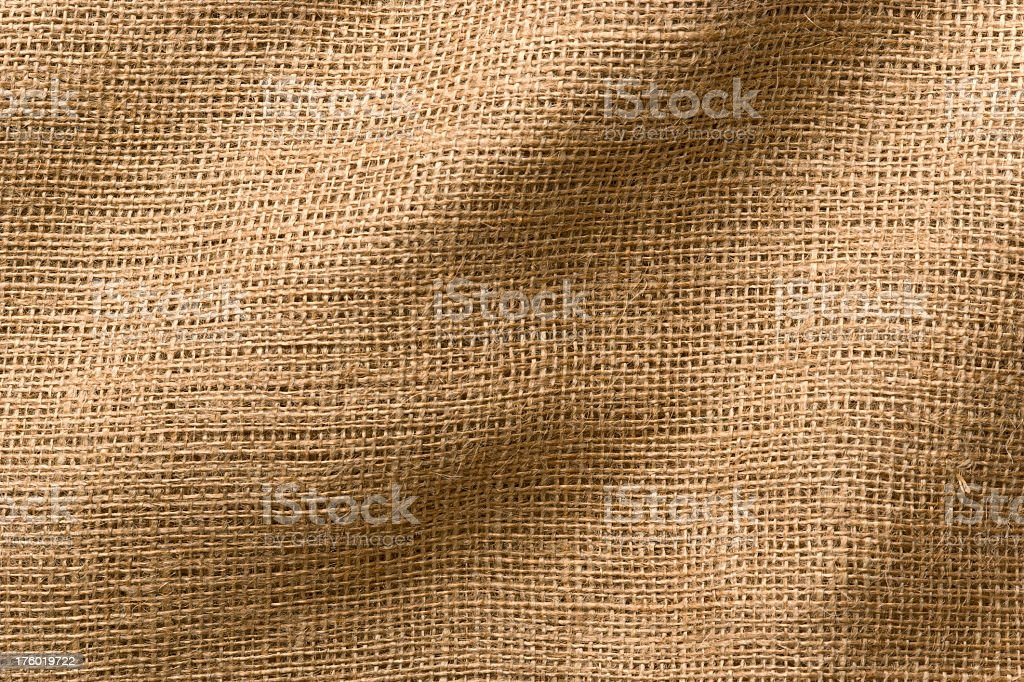 Burlap Fabric with Wrinkles, Close-Up. Full Frame. royalty-free stock photo