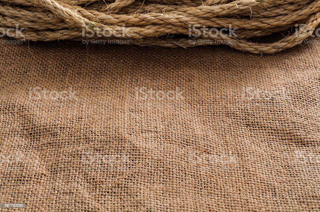 Burlap material background with rope stock photo