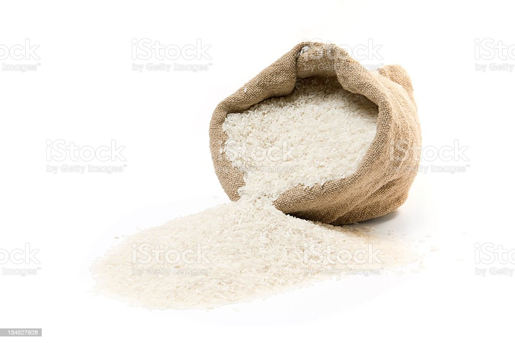 Burlap sack and scattered rice stock photo