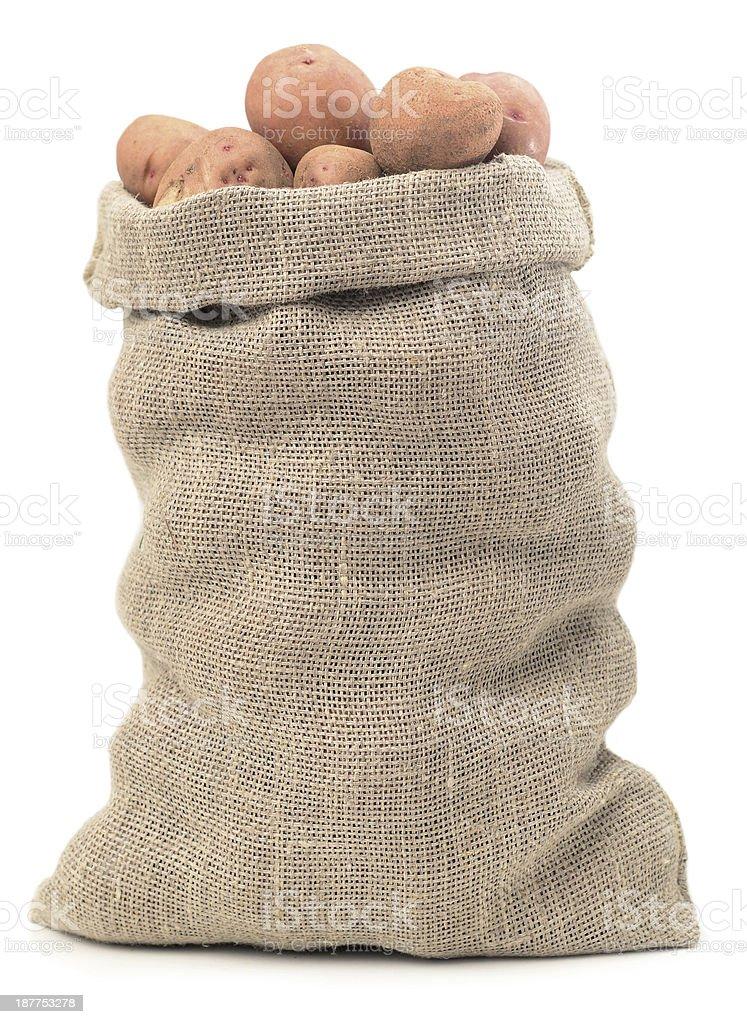 Burlap sack filled with potatoes stock photo