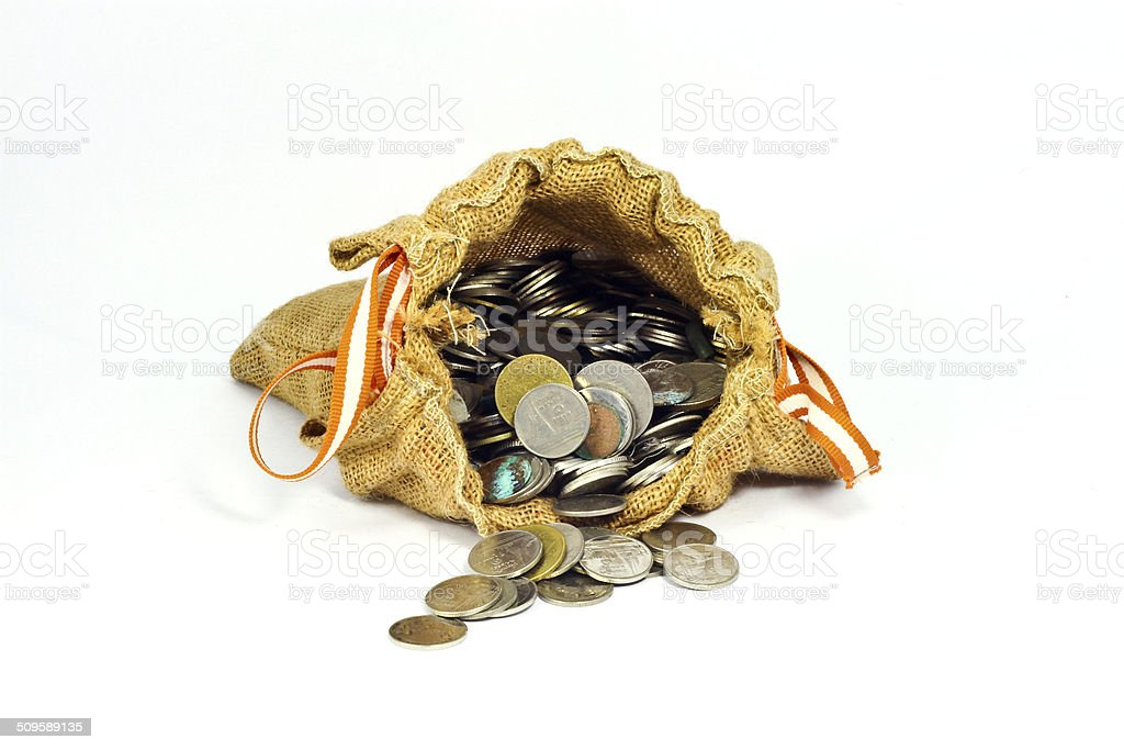 burlap sack full of coins  and stack of coins stock photo