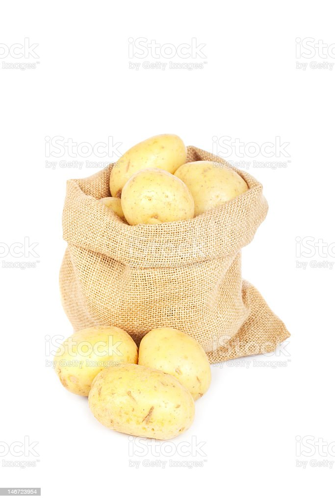 Burlap sack with potatoes royalty-free stock photo