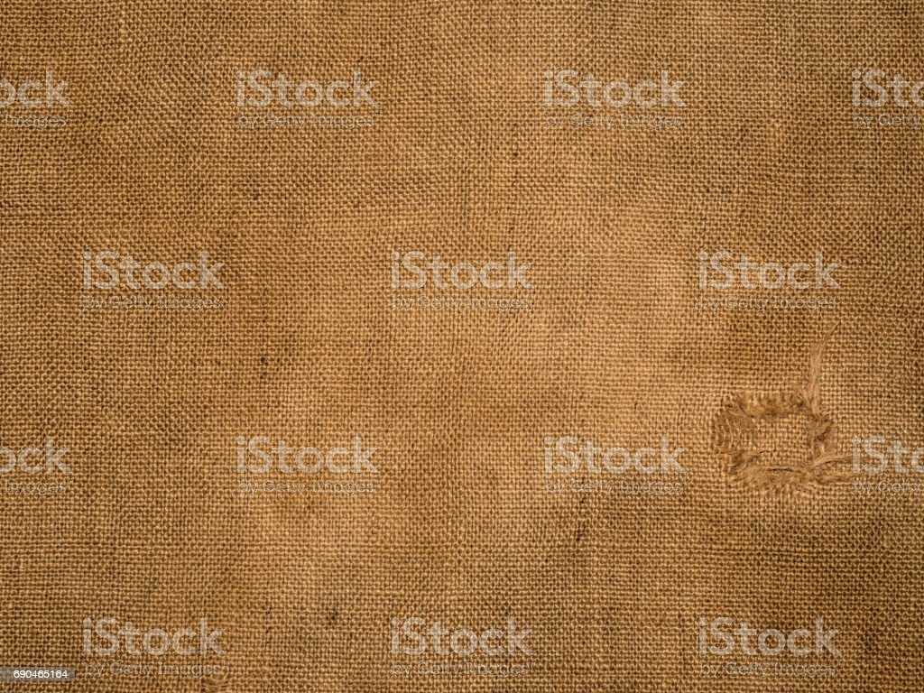 Burlap surface with a hole stock photo