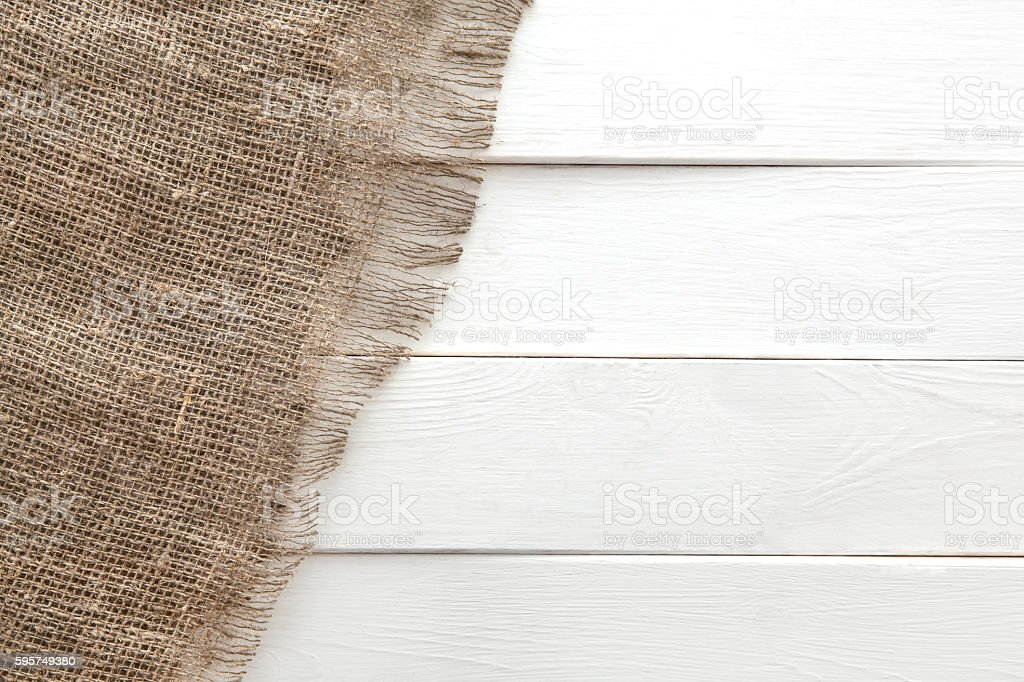 Burlap texture on white wooden background stock photo