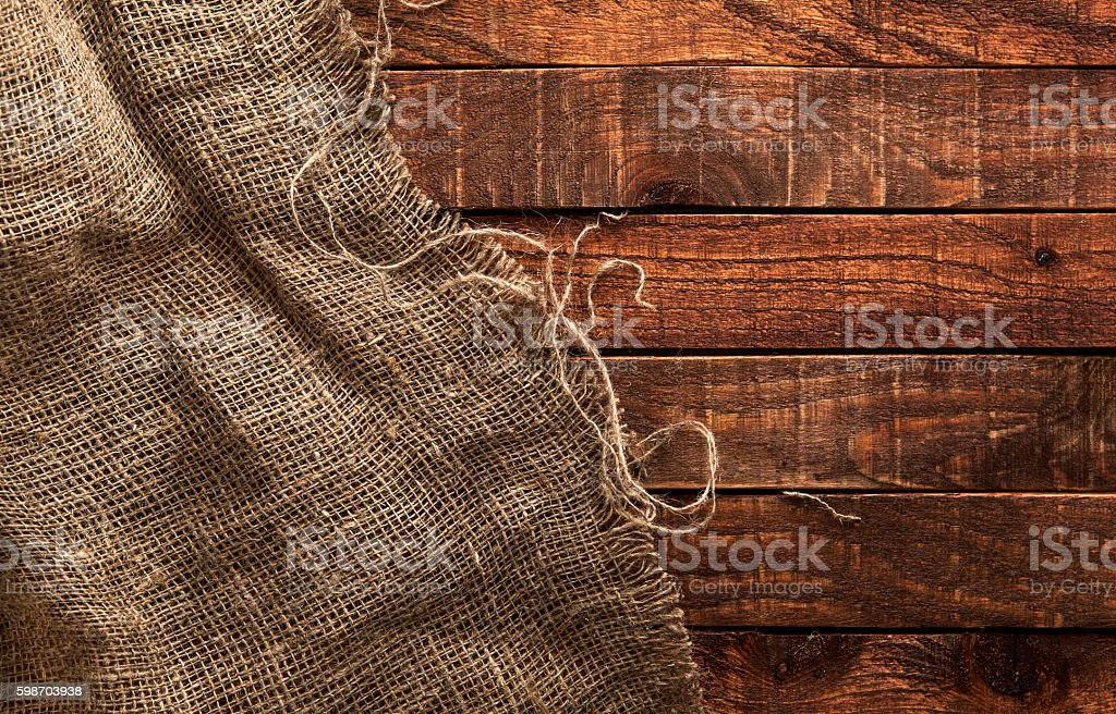 Burlap texture on wooden background stock photo