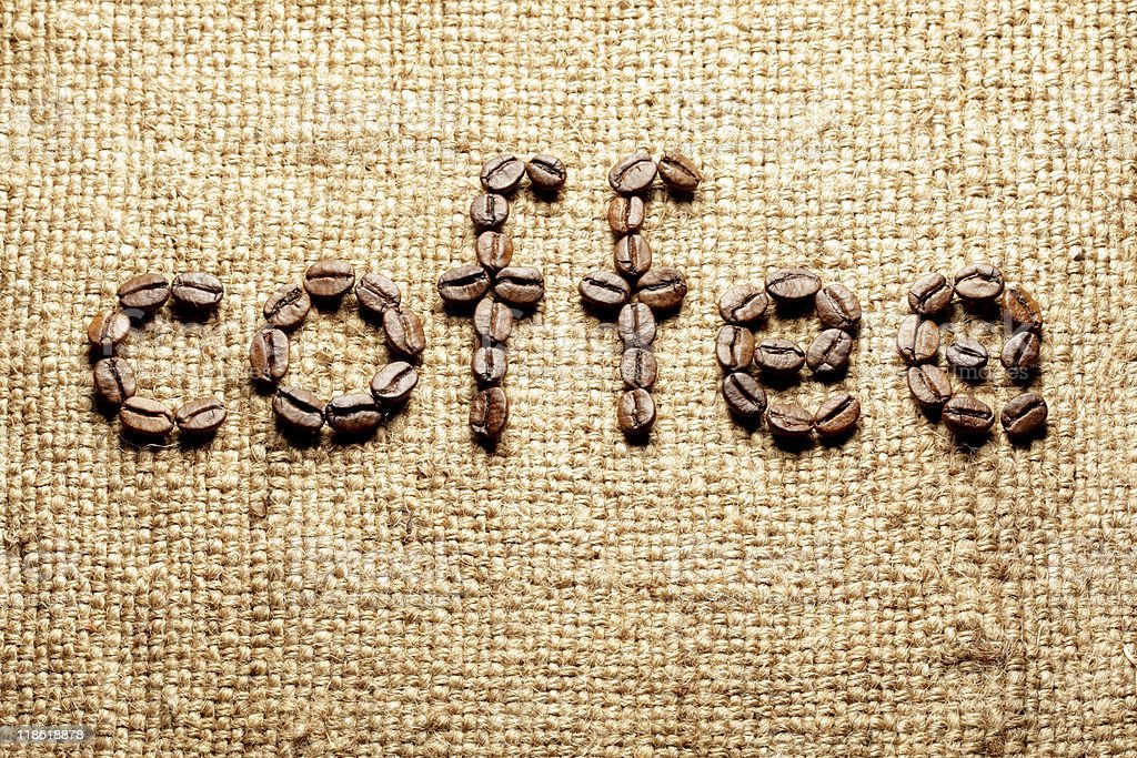 Burlap with coffee inscription royalty-free stock photo