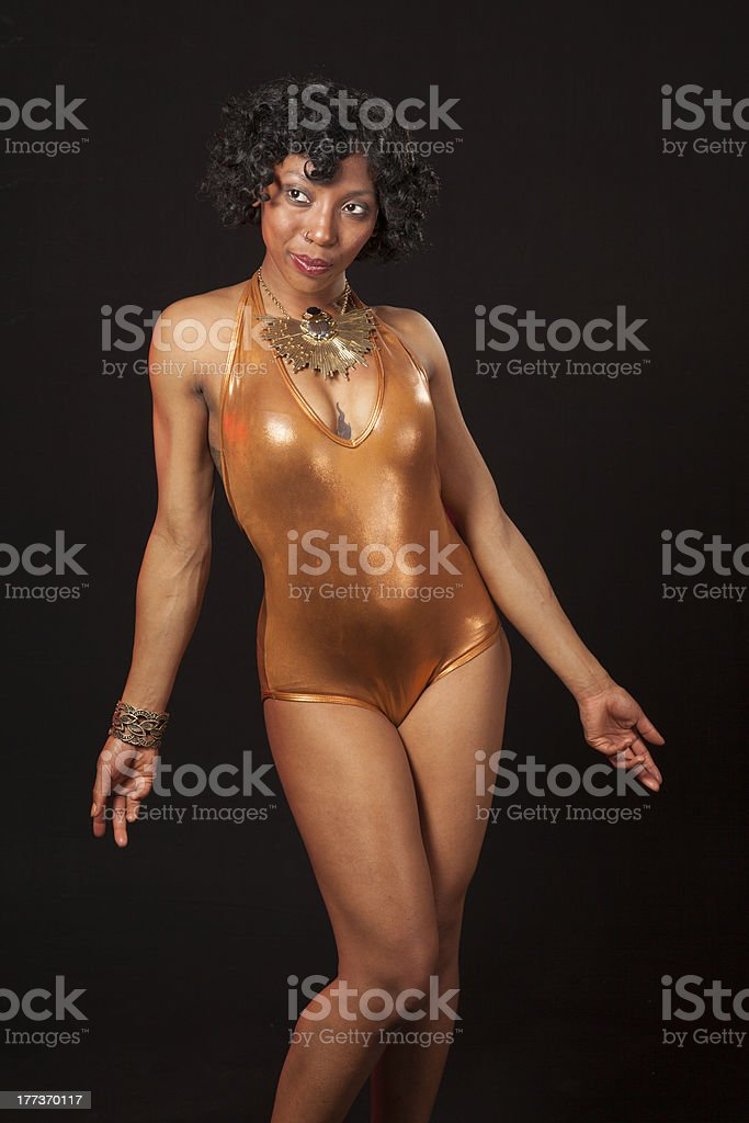 burlesque dancer in gold leotard stock photo