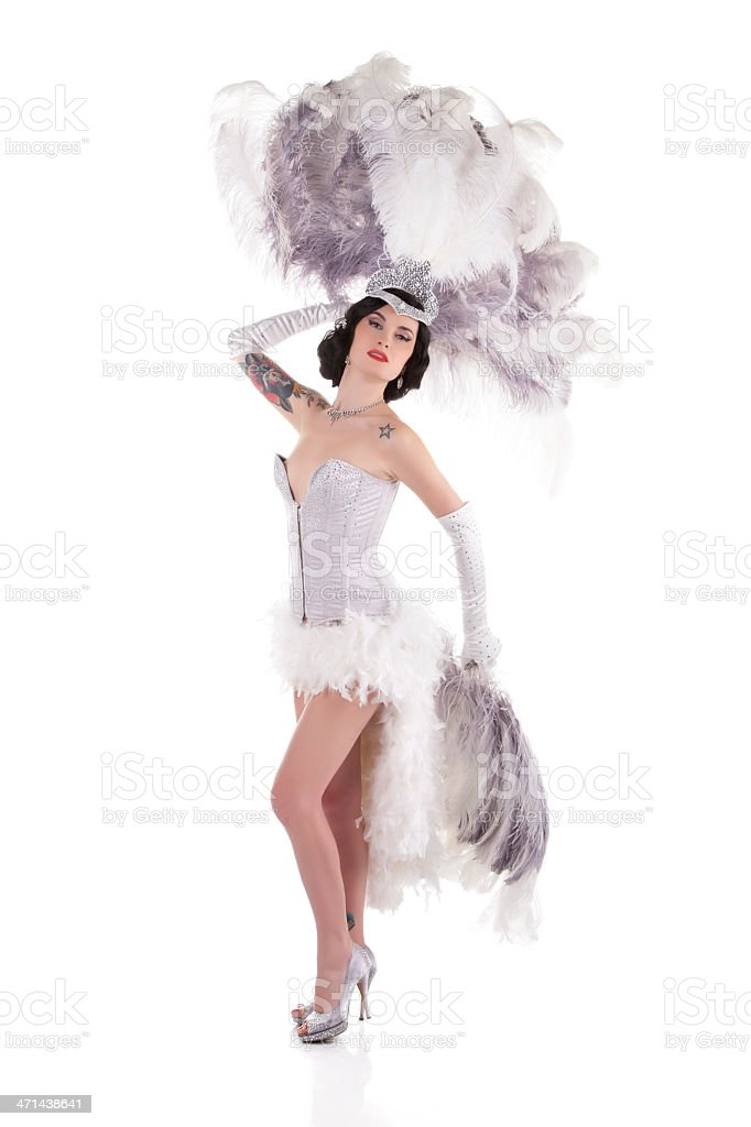 Burlesque female dancer with white and gray feathers stock photo