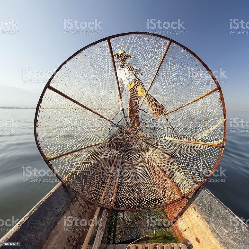 Burma Myanmar Inle lake fisherman on boat catching fish stock photo