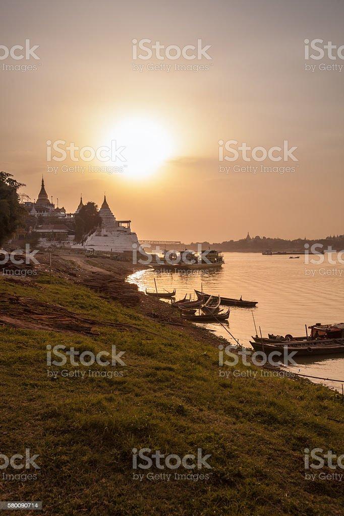 Burmese boats at dusk stock photo