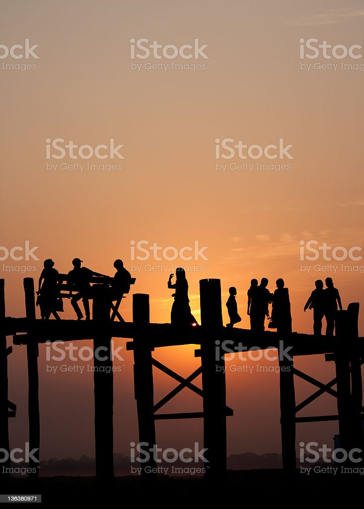 Burmese crossing U Bein Bridge, Burma stock photo