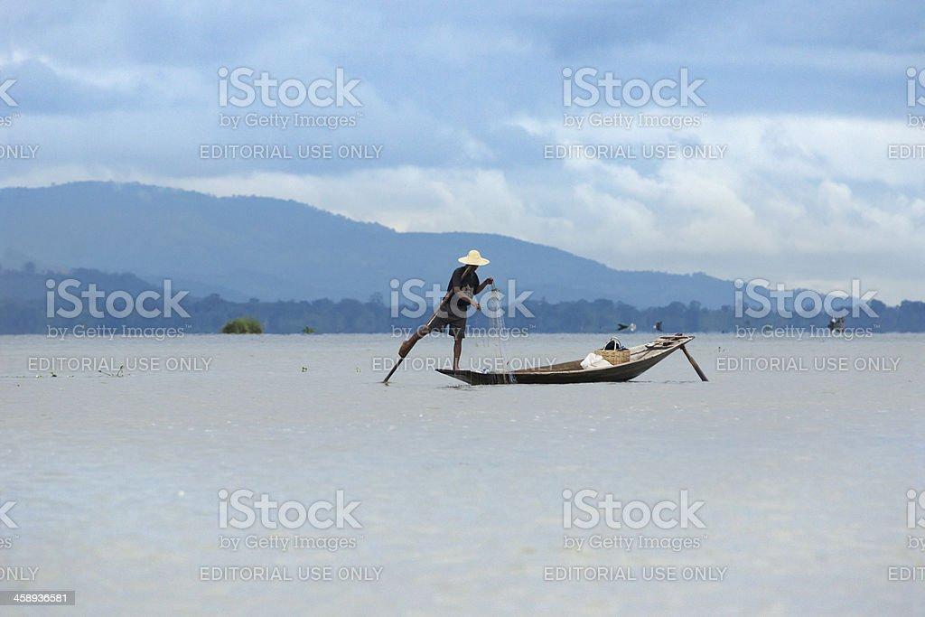 Burmese fisherman standing on a canoe, Inle Lake royalty-free stock photo