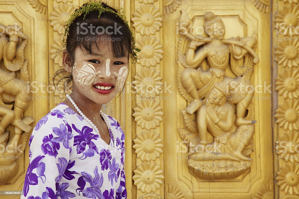 Burmese Girl With Tanaka Painted on Her Face stock photo