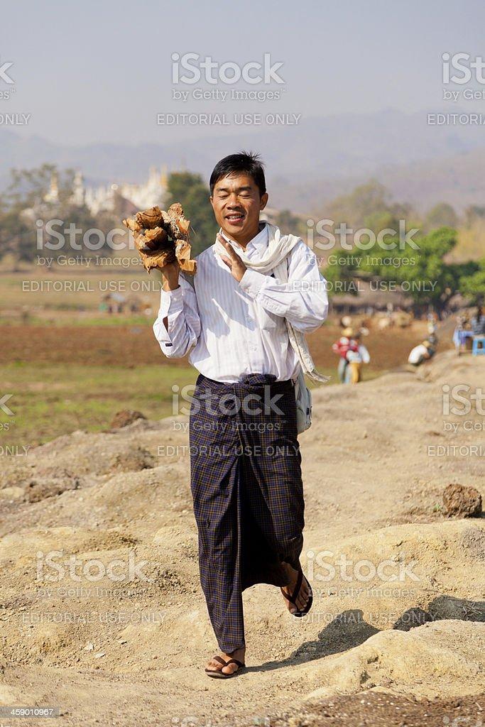 Burmese man carring wood stock photo