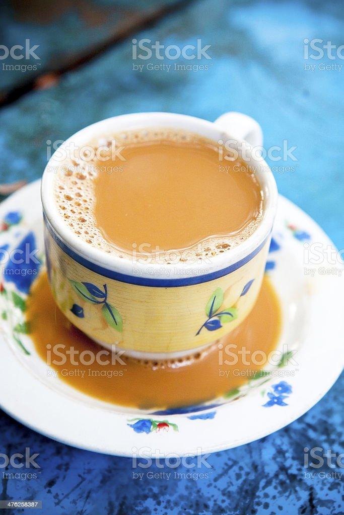 Burmese milk tea on blue wooden table royalty-free stock photo