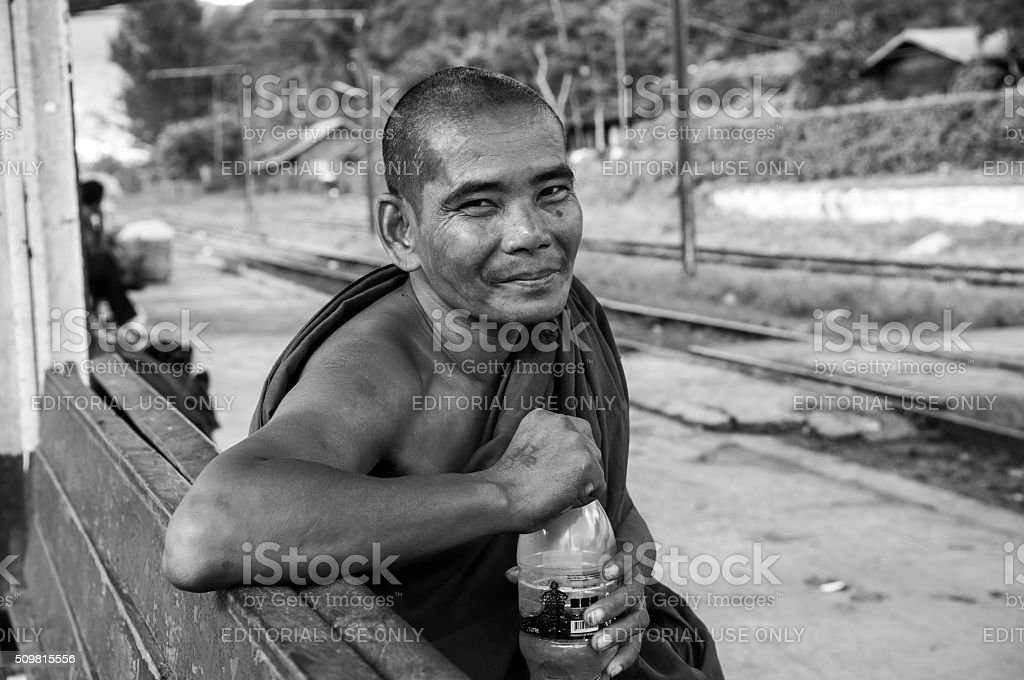 Burmese monk at train station in Kalaw, Myanmar stock photo