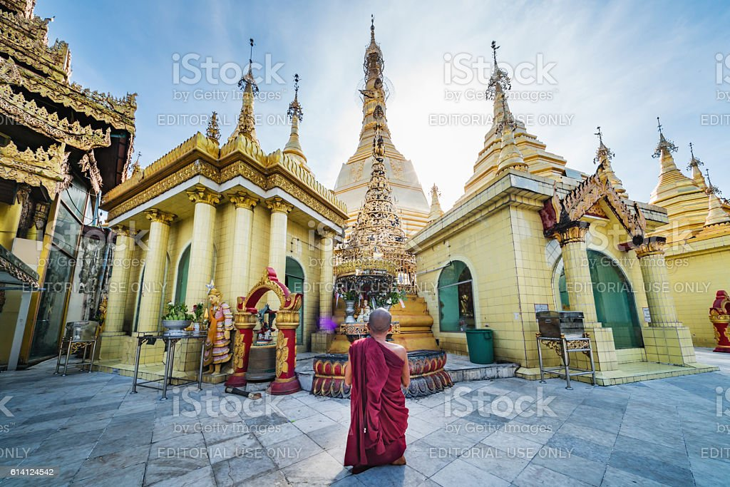 Burmese Monk Praying at Sule Pagoda Myanmar stock photo