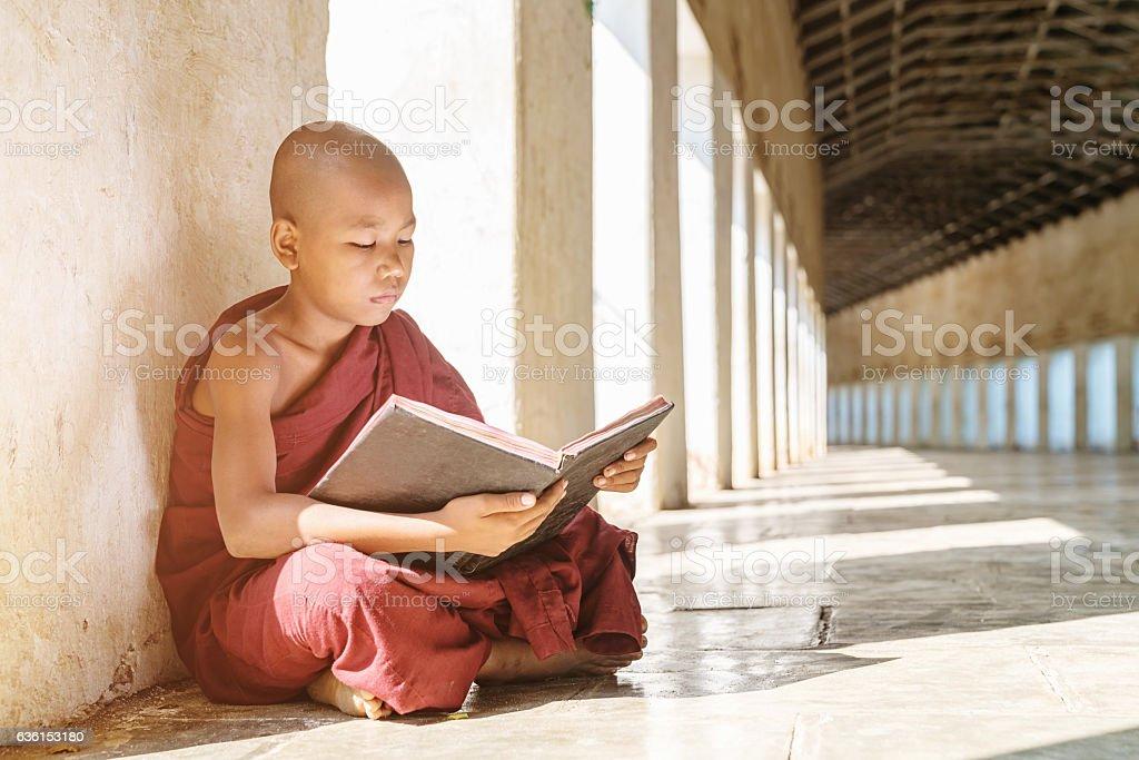 Burmese Monk Reading Buddhist Book Monastery Archway Bagan Myanmar stock photo
